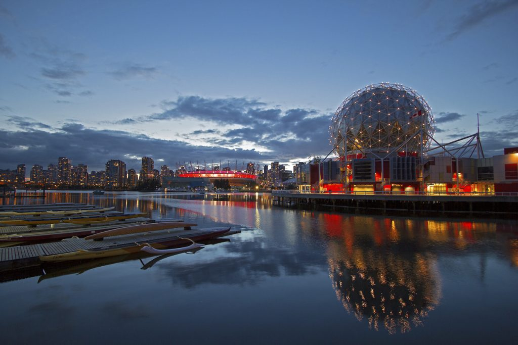 Vancouver cityscape at night time with Science World in the foreground