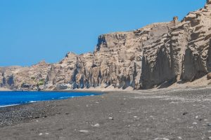 Beautiful black sand beach on Santorini island, Greece.